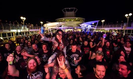 Black metal and pina coladas … revellers enjoy the music.