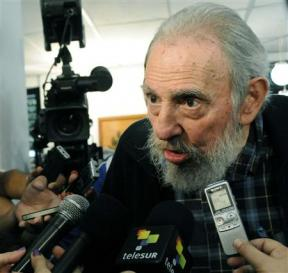 Former Cuban leader Castro speaks to reporters at a polling station in Havana