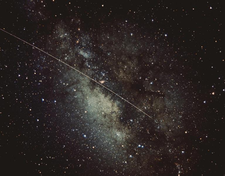 meteorite-streak-running-through-the-milky-way-stocktrek