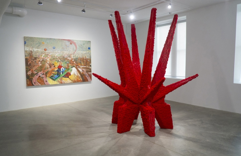 A view of Cuban Forever at the Pizzuti Collection. At left, Ladacar III, 2010, by Douglas Pérez; at right, Los Carpinteros, Kosmaj Toy, 2012