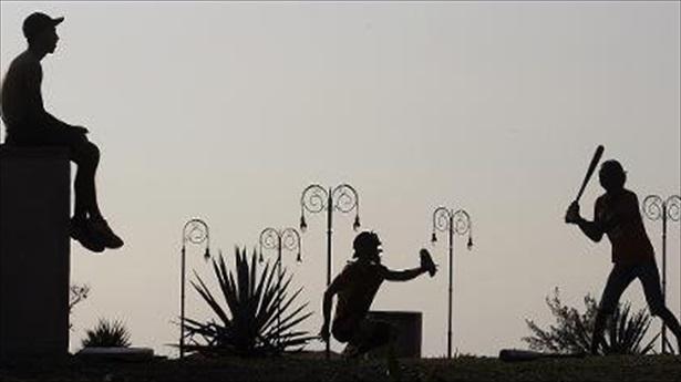 Cubans-play-baseball-in-a-park-in-Havana-on-April-18-2007_-AFP