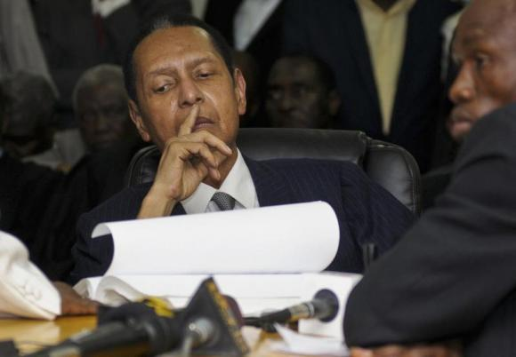Former Haitian dictator Duvalier listens as charges against him are announced during an appeals court hearing in Port-au-Prince