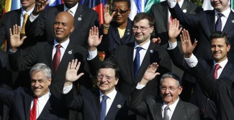 File photo of world leaders waving to the media during the group picture during the summit of the CELAC-UE in Santiago