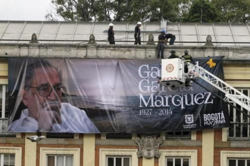 Workers install a banner of the late Nobel Laureate Gabriel Garcia Marquez in Bogota