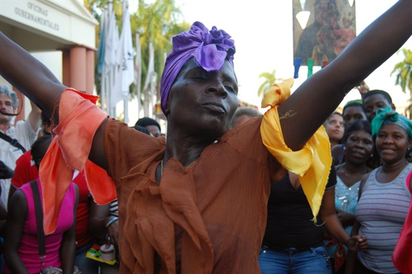 "A woman dances Gaga Afro-Caribbean music during a protest against racial discrimination and ""denationalization"" of Dominicans of Haitian descent, Santo Domingo, Dominican Republic, March 21, 2014"