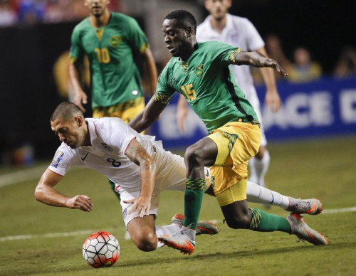 United States' Clint Dempsey (8) and Jamaica's Je-Vaughn Watson (15) vie for at the ball during the first half of a CONCACAF Gold Cup soccer semifinal, Wednesday, July 22, 2015, in Atlanta. (AP Photo/John Bazemore)