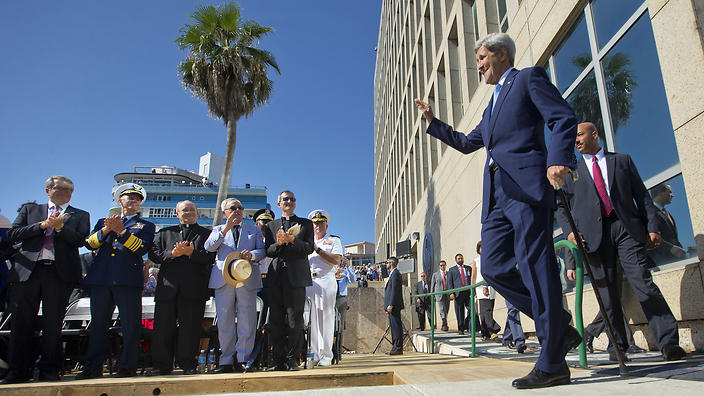 Secretary of State John Kerry waves to guests and other dignitaries before the raising of the U.S. flag over the newly reopened embassy in Havana, Cuba. Friday, Aug. 14, 2015. Kerry traveled to the Cuban capital to raise the U.S. flag and formally reopen the long-closed U.S. Embassy. Cuba and U.S. officially restored diplomatic relations July 20, as part of efforts to normalize ties between the former Cold War foes. (AP Photo/Pablo Martinez Monsivais,Pool)