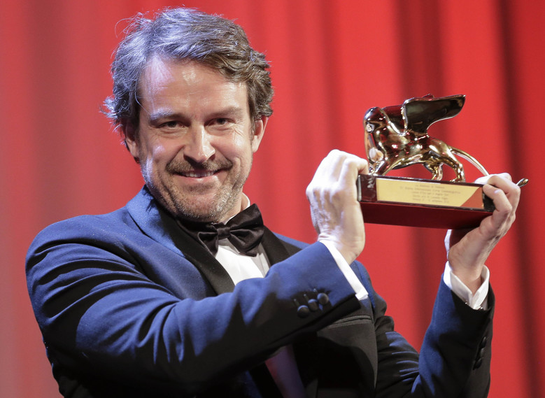 Director Lorenzo Vigas receives the Golden Lion for best film for 'Desde Alla' (From afar) during the awards ceremony of the 72nd edition of the Venice Film Festival in Venice, Italy, Saturday, Sept. 12, 2015. (AP Photo/Andrew Medichini)