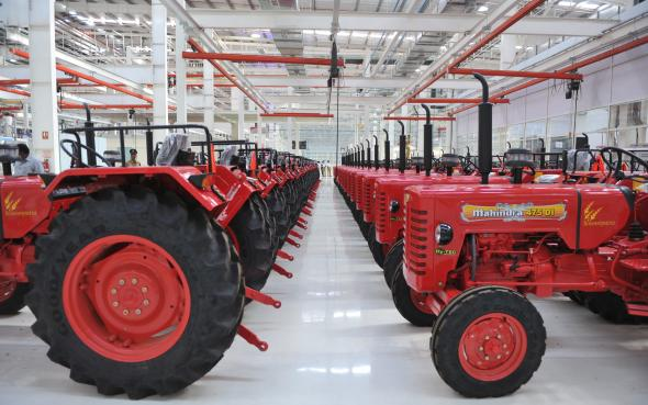163198690-indian-employees-stand-near-tractors-at-a-new-mahindra.jpg.CROP.promovar-mediumlarge.jpg