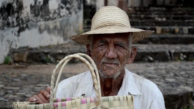472542276-cuban-straw-hat-street-vendor-basket-receptable.jpg