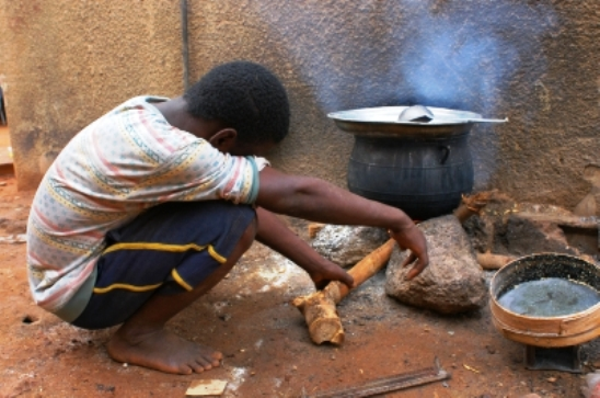Poverty-child-cooking-with-firewood